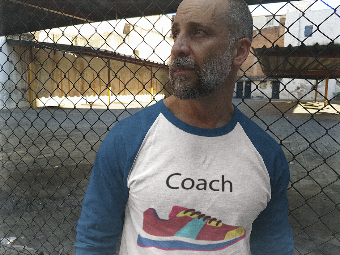 middle-aged-white-man-staring-away-and-leaning-against-a-rusty-fence-raglan-tee-mockup-b12613
